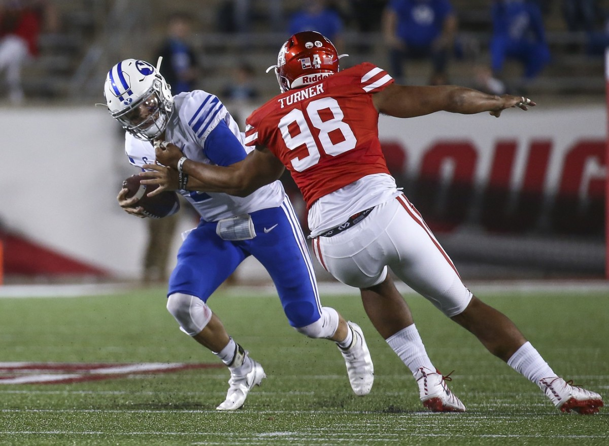 Brigham Young quarterback Zach Wilson (1) is sacked by Houston Cougars defensive lineman Payton Turner (98). Mandatory Credit: Troy Taormina-USA TODAY