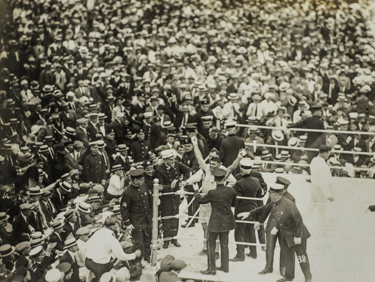 Dempsey had Carpentier on the ropes before celebrating his fourth round knockout.