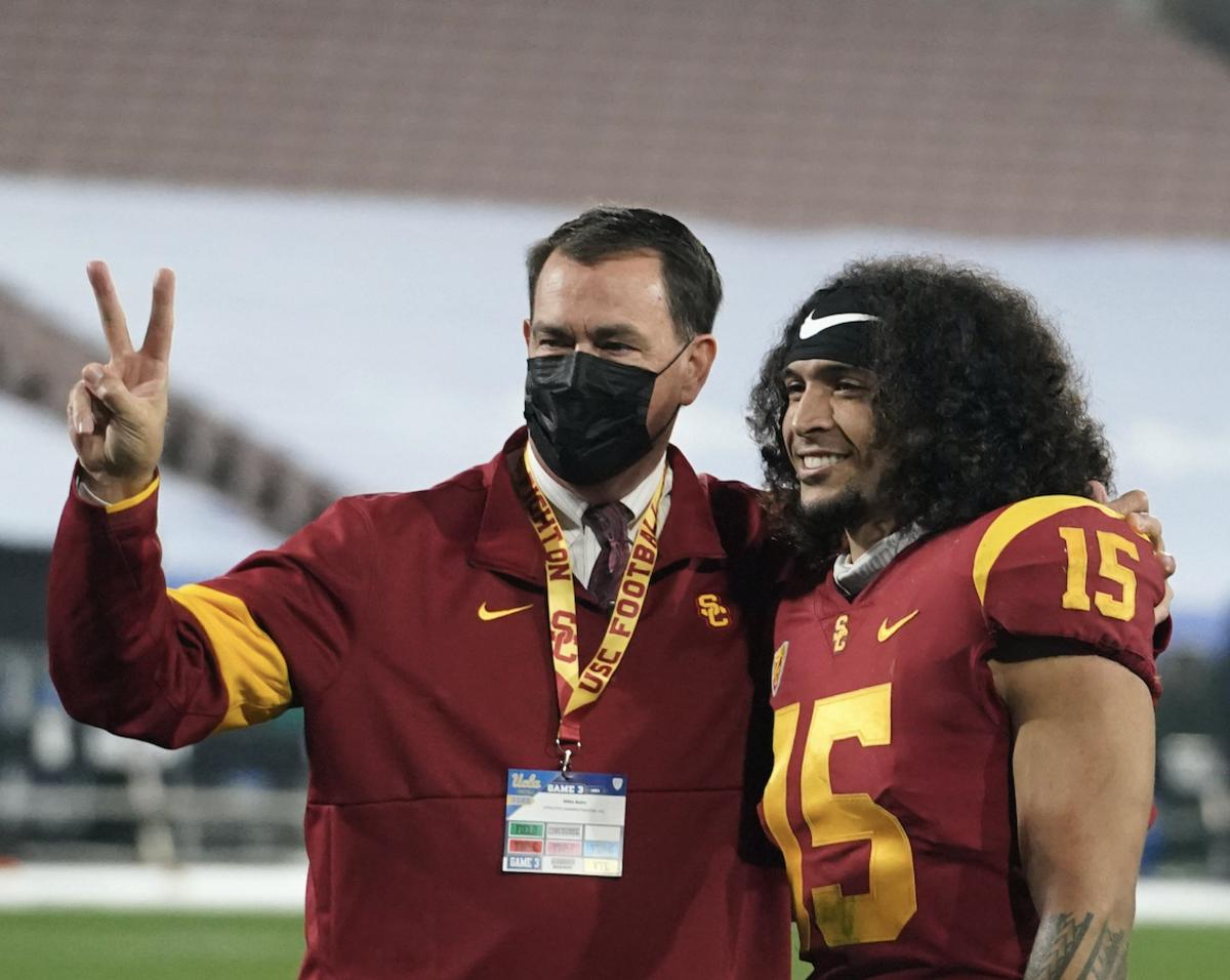 USC Athletic Director Mike Bohn (left), USC S Talanoa Hufanga (right) [USA TODAY]
