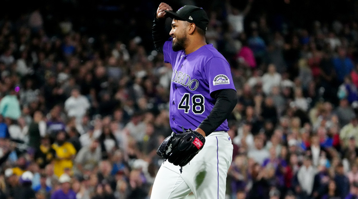 Jun 29, 2021; Denver, Colorado, USA; Colorado Rockies starting pitcher German Marquez (48) celebrates defeating the Pittsburgh Pirates at Coors Field.