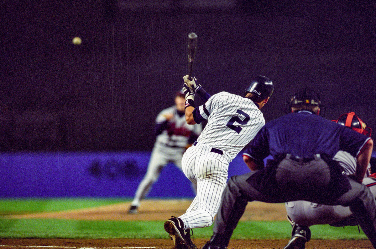 Derek Jeter hits an RBI single in Game 6 of the 1996 World Series at Yankee Stadium.