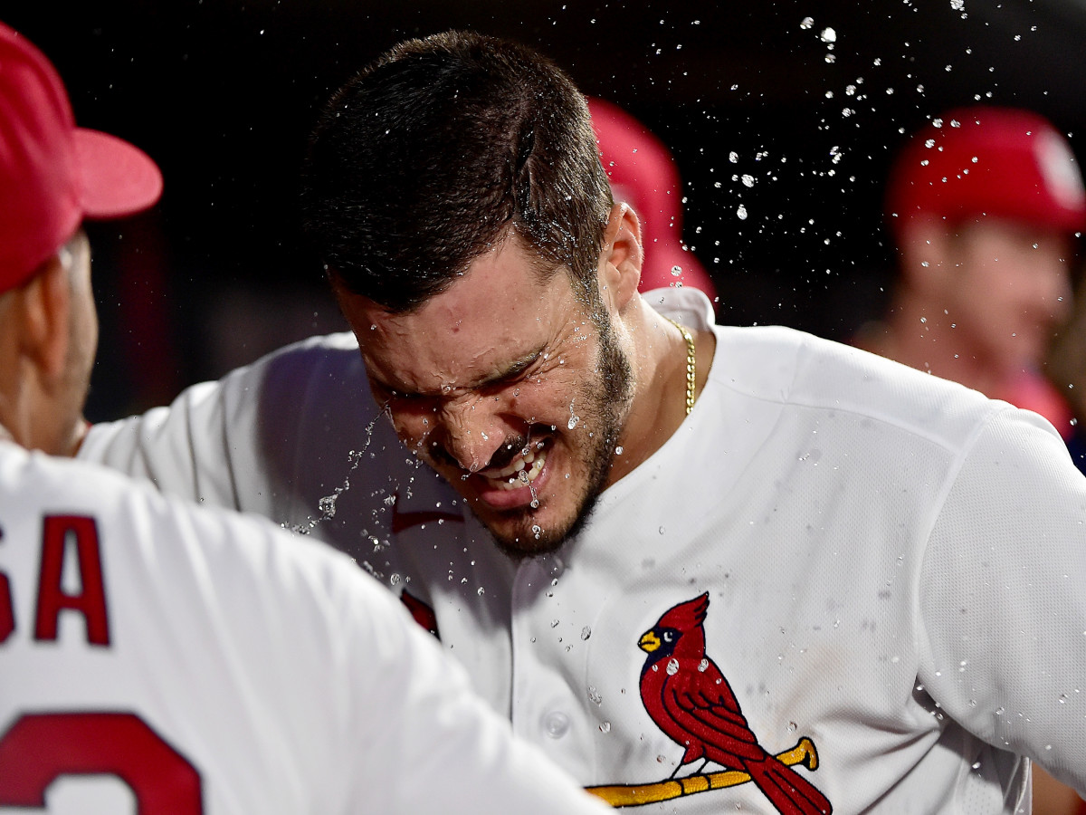 Jun 25, 2021; St. Louis, Missouri, USA;  St. Louis Cardinals third baseman Nolan Arenado (28) is splashed with water by shortstop Edmundo Sosa (63) after hitting a solo home run during the third inning against the Pittsburgh Pirates at Busch Stadium.