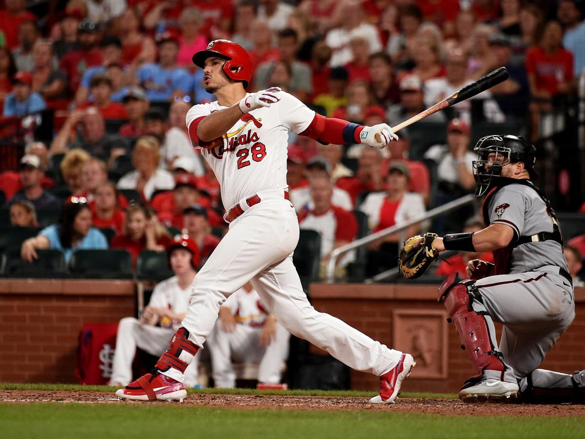 Jun 29, 2021; St. Louis, Missouri, USA; St. Louis Cardinals third baseman Nolan Arenado (28) hits a two run home run against the Arizona Diamondbacks during the fifth inning at Busch Stadium.