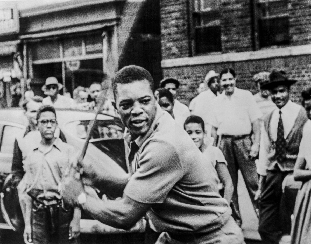 Willie Mays playing stick ball with kids in Harlem, N.Y.