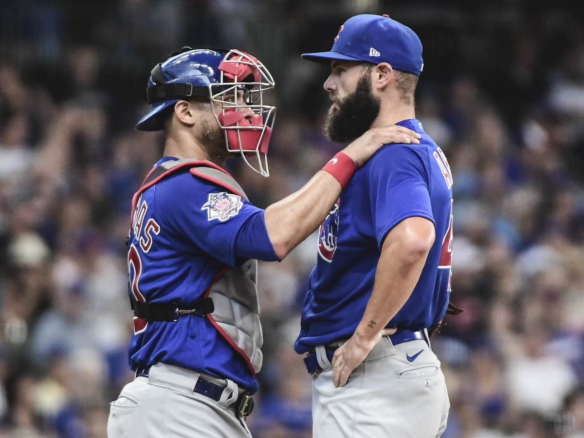 Chicago Cubs catcher Willson Contreras (40) talks to pitcher Jake Arrieta (49) in the first inning during the game against the Milwaukee Brewersat American Family Field.