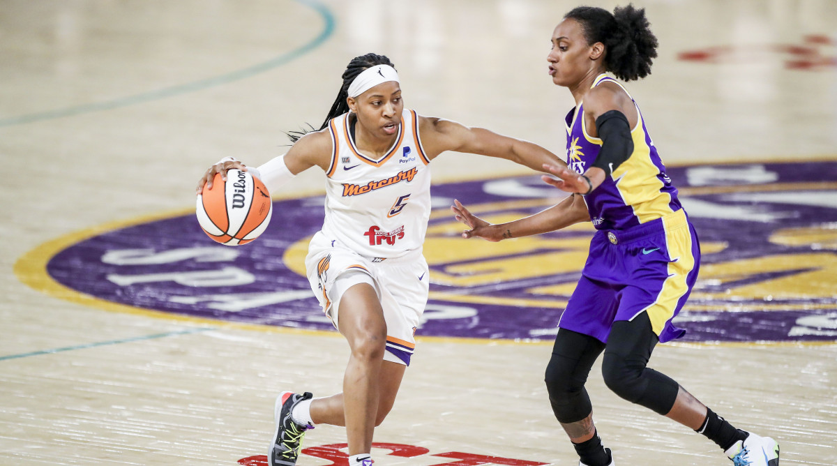 Brittney Sykes guarding a player on defense