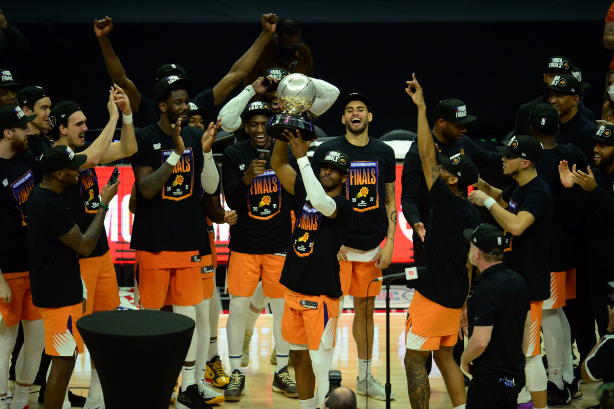 Jun 30, 2021; Los Angeles, California, USA; Phoenix Suns guard Chris Paul (3) lifts the Western Conference champions trophy following the series victory against the Los Angeles Clippers in game six of the Western Conference Finals for the 2021 NBA Playoffs at Staples Center. Mandatory Credit: Gary A. Vasquez-USA TODAY Sports