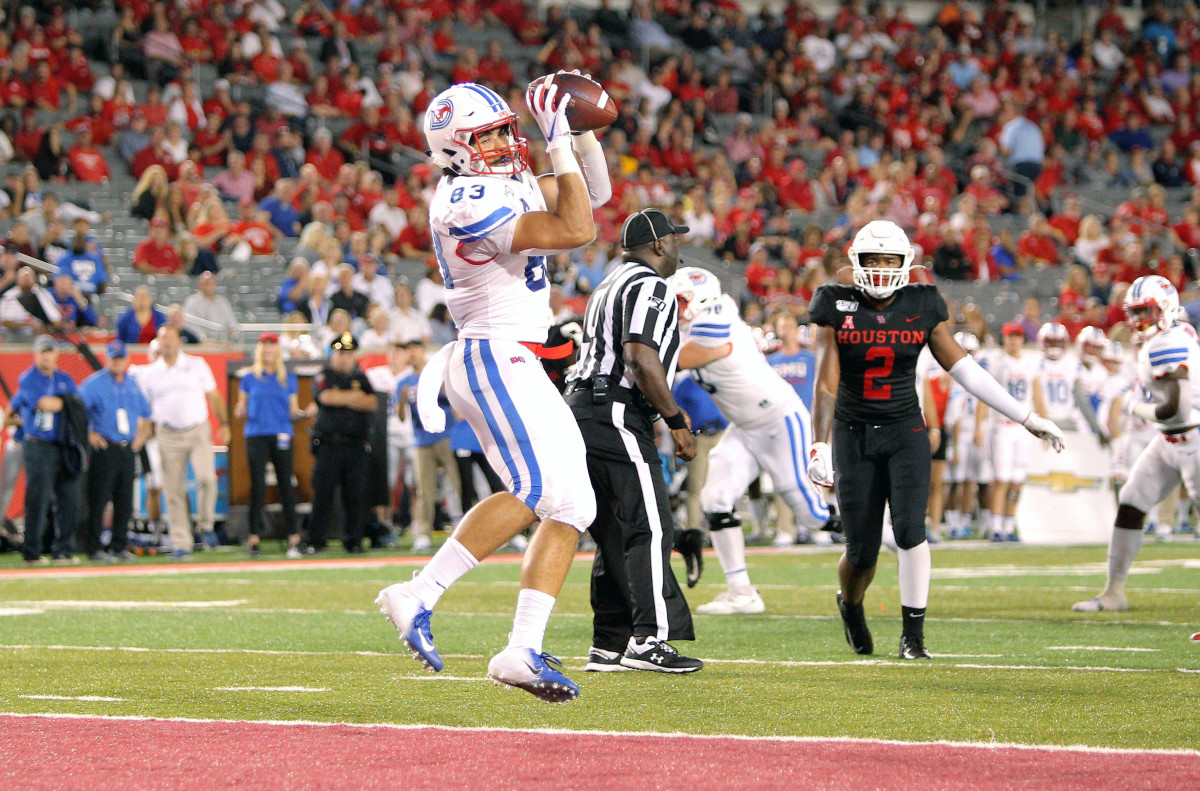 Oct 24, 2019; Houston, TX, USA; Southern Methodist Mustangs tight end Kylen Granson (83) catches the ball in the end zone for a touchdown against the Houston Cougars during the second quarter at TDECU Stadium.