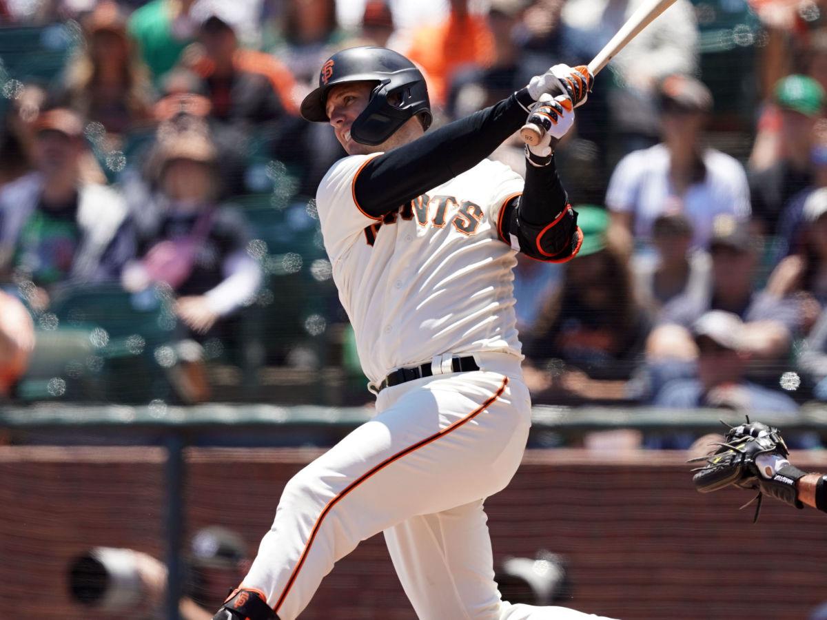 Buster Posey swings the bat
