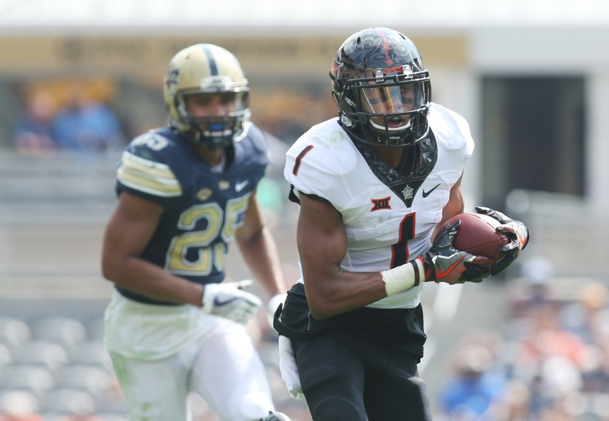 Oklahoma State wide receiver Jalen McCleskey (1) runs after a catch against the Pitt Panthers. Mandatory Credit: Charles LeClaire-USA TODAY