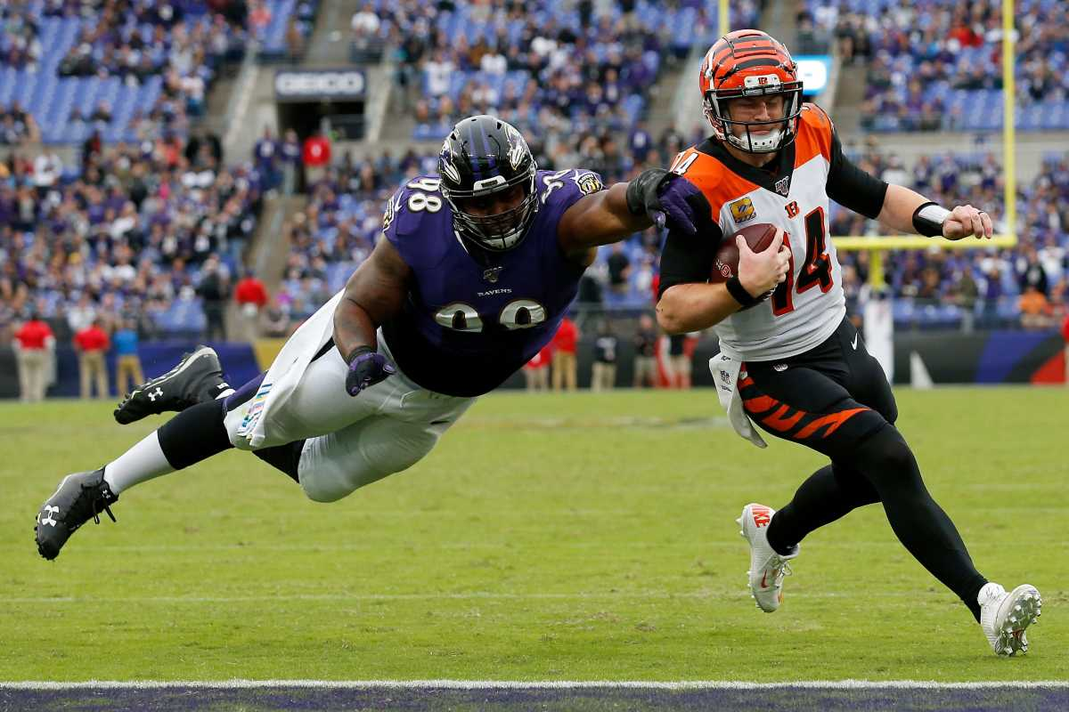 Brandon Williams attempts a tackle on former Bengals QB Andy Dalton.
