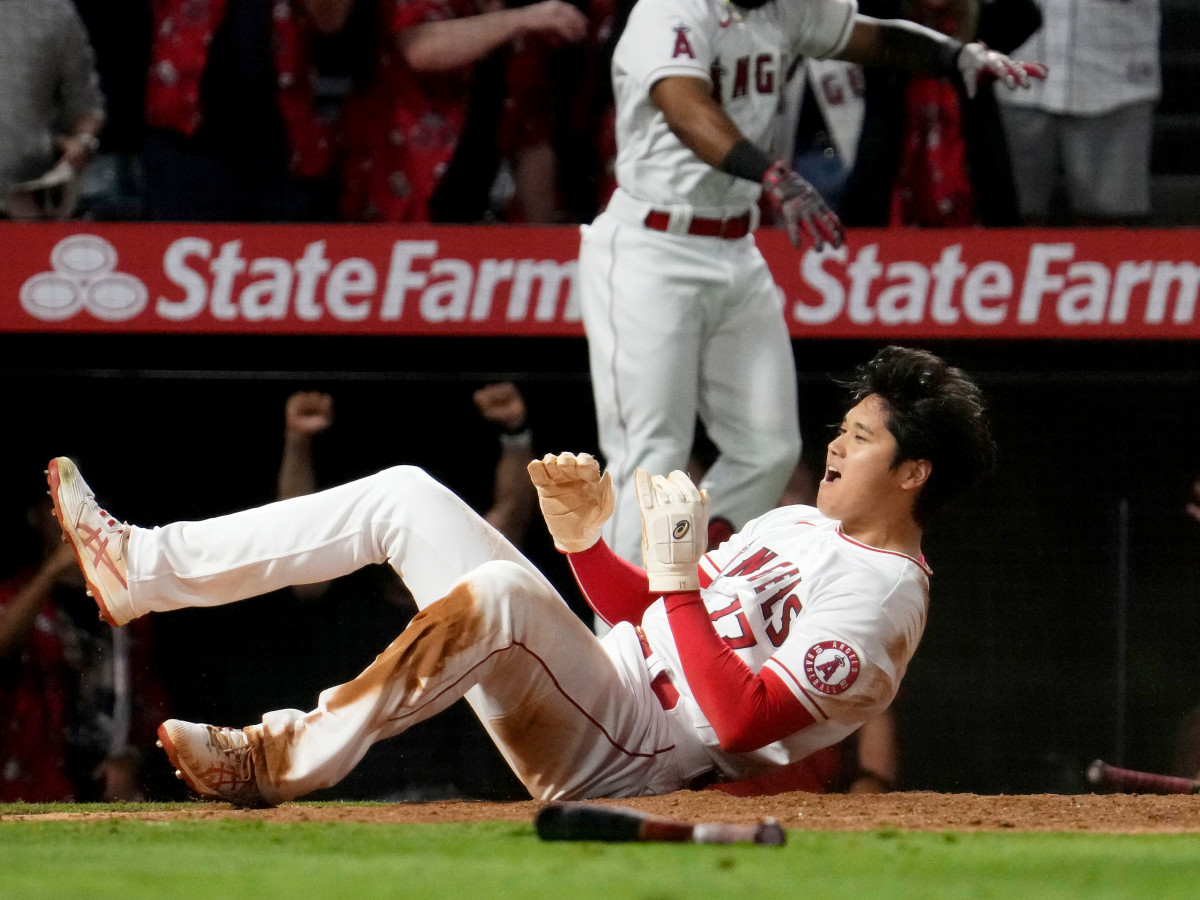 Shohei Ohtani reacts after sliding in safely at home and scoring the winning run in the ninth inning as the Angels defeated the Orioles, 8–7, at Angel Stadium on July 2.