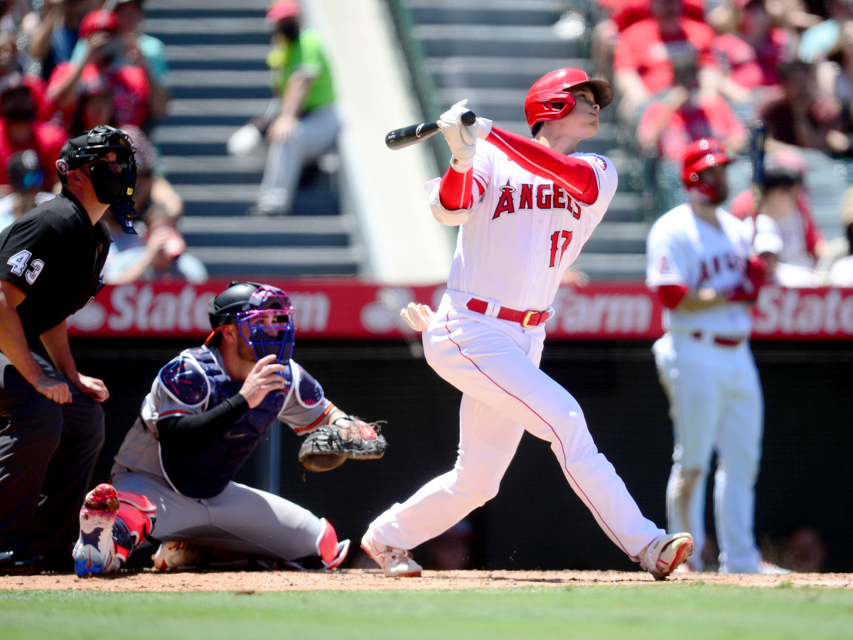 Jul 4, 2021; Anaheim, California, USA; Los Angeles Angels designated hitter Shohei Ohtani (17) hits a solo home run against the Baltimore Orioles during the third inning at Angel Stadium.