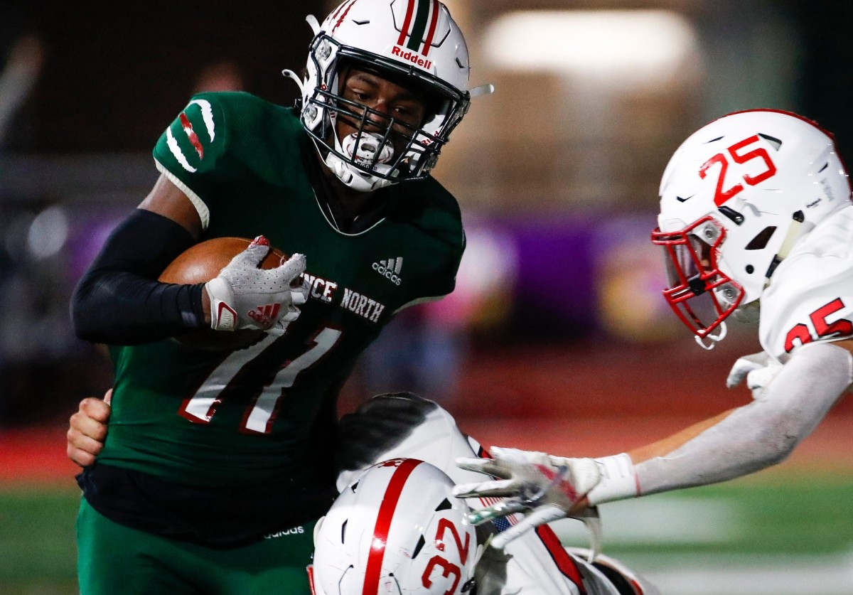 Lawrence North's Omar Cooper (11) breaks a tackle in a game against Center Grove. Cooper is the top-ranked receiver in Indiana. (Grace Hollars/USA Today Sports)