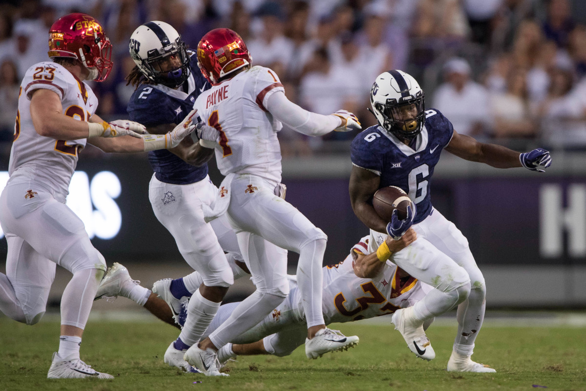 Sep 29, 2018; Fort Worth, TX, USA; Iowa State Cyclones linebacker Mike Rose (23) and defensive back D'Andre Payne (1) and TCU Horned Frogs running back Darius Anderson (6) in action during the game at Amon G. Carter Stadium.