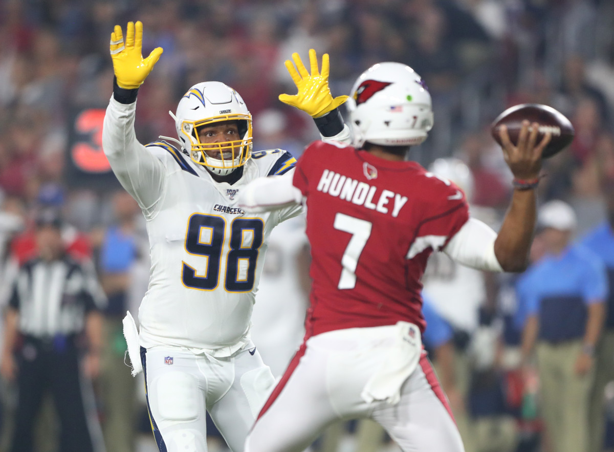 Aug 8, 2019; Glendale, AZ, USA; Los Angeles Chargers defensive end Isaac Rochell (98) pressures Arizona Cardinals quarterback Brett Hundley (7) in the first half during a preseason game at State Farm Stadium.