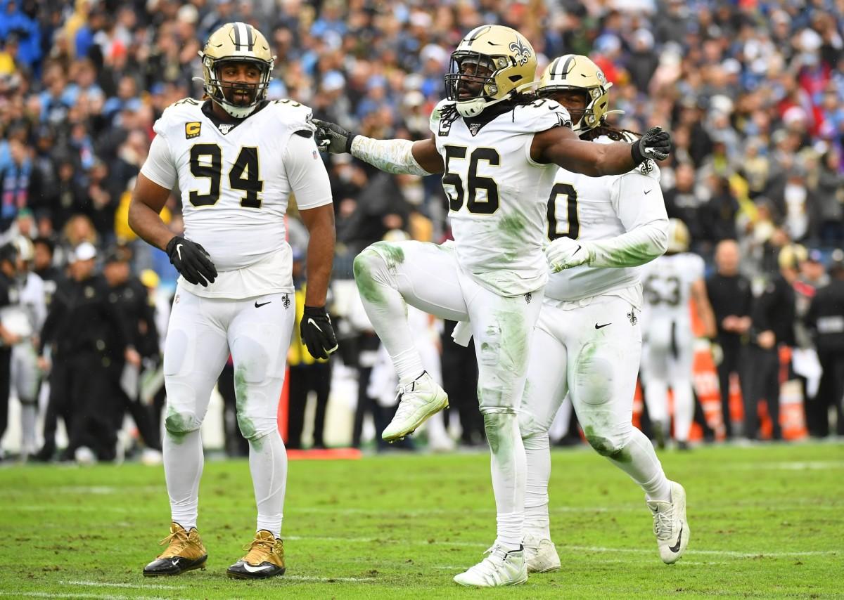 Saints defensive end Cameron Jordan (94) and linebacker Demario Davis (56) celebrate after a sack. Mandatory Credit: Christopher Hanewinckel-USA TODAY Sports