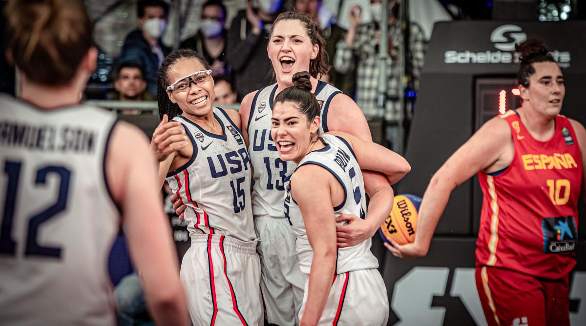 Allisha Gray, Stefanie Dolson and Kelsey Plum embrace