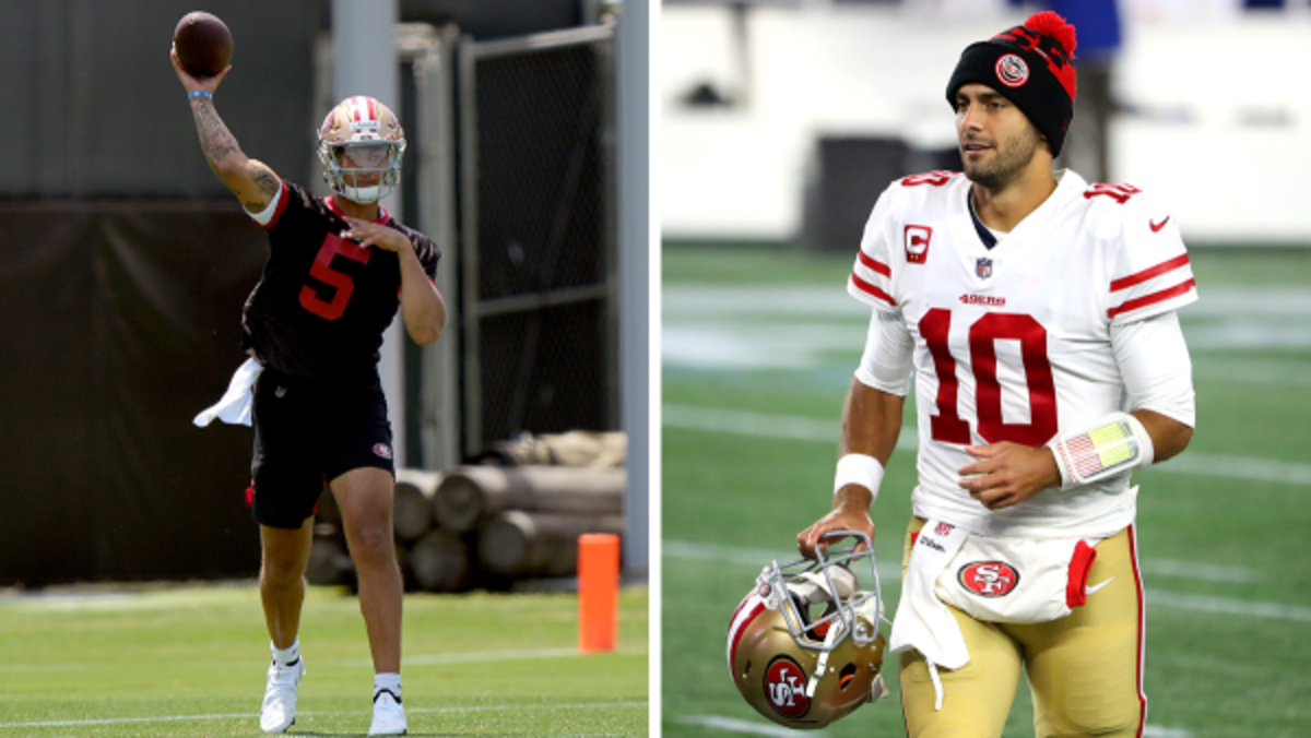 49ers rookie quarterback Trey Lance attempts a pass in minicamp; Incumbent Niners QB Jimmy Garoppolo exits the field prior to kickoff