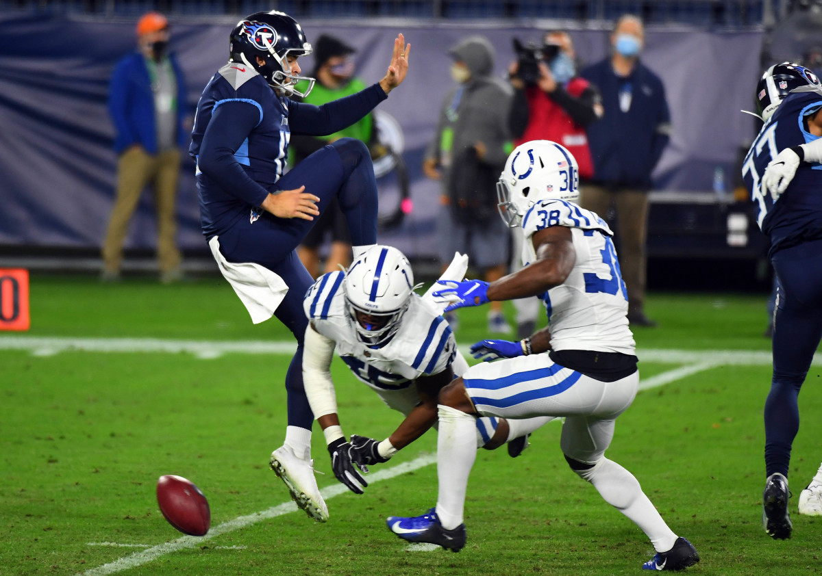 Nov 12, 2020; Nashville, Tennessee, USA; Tennessee Titans punter Trevor Daniel (12) has a punt blocked by Indianapolis Colts linebacker E.J. Speed (45) during the second half at Nissan Stadium. The recovery was taken in for a touchdown by Indianapolis Colts cornerback T.J. Carrie (38).