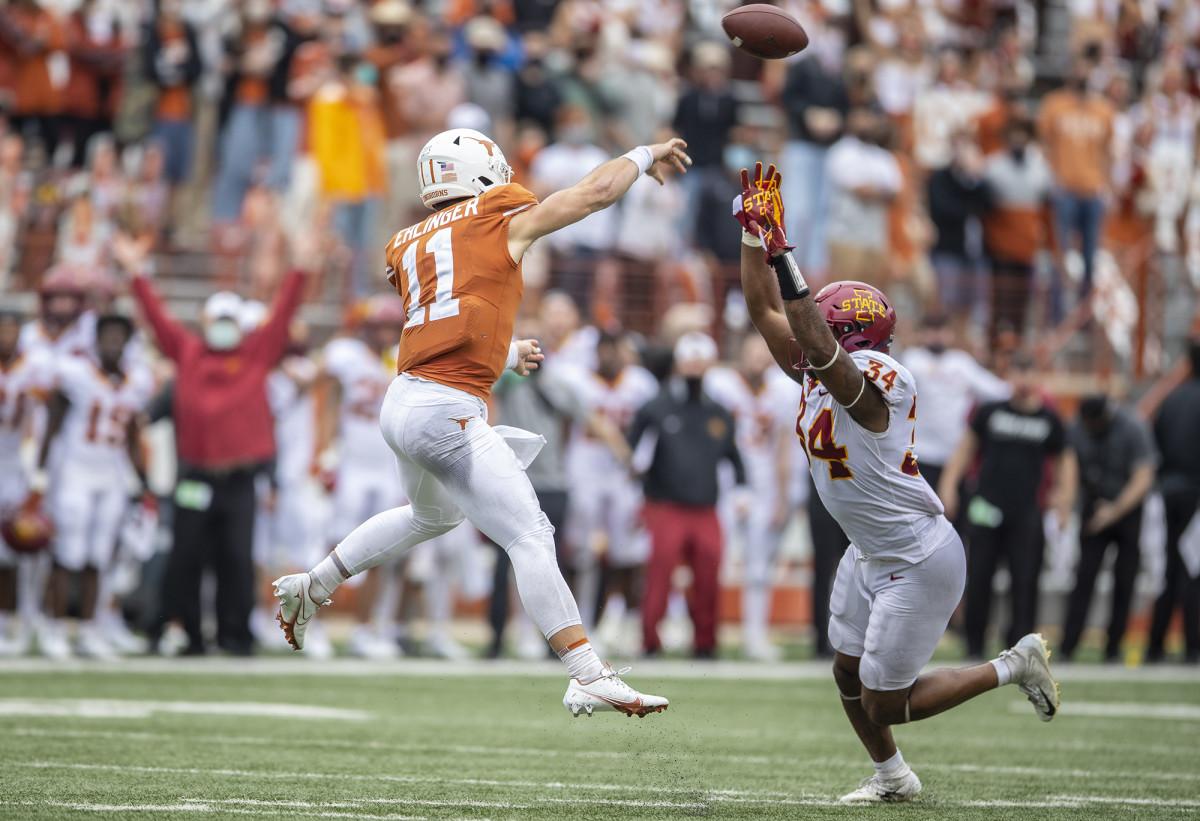 Nov 27, 2020; Austin, TX, USA; Texas Longhorns quarterback Sam Ehlinger (11) passes the ball as Iowa State Cyclones linebacker O'Rien Vance (34) tries to defend during an NCAA college football game at Darrell K Royal-Texas Memorial Stadium.