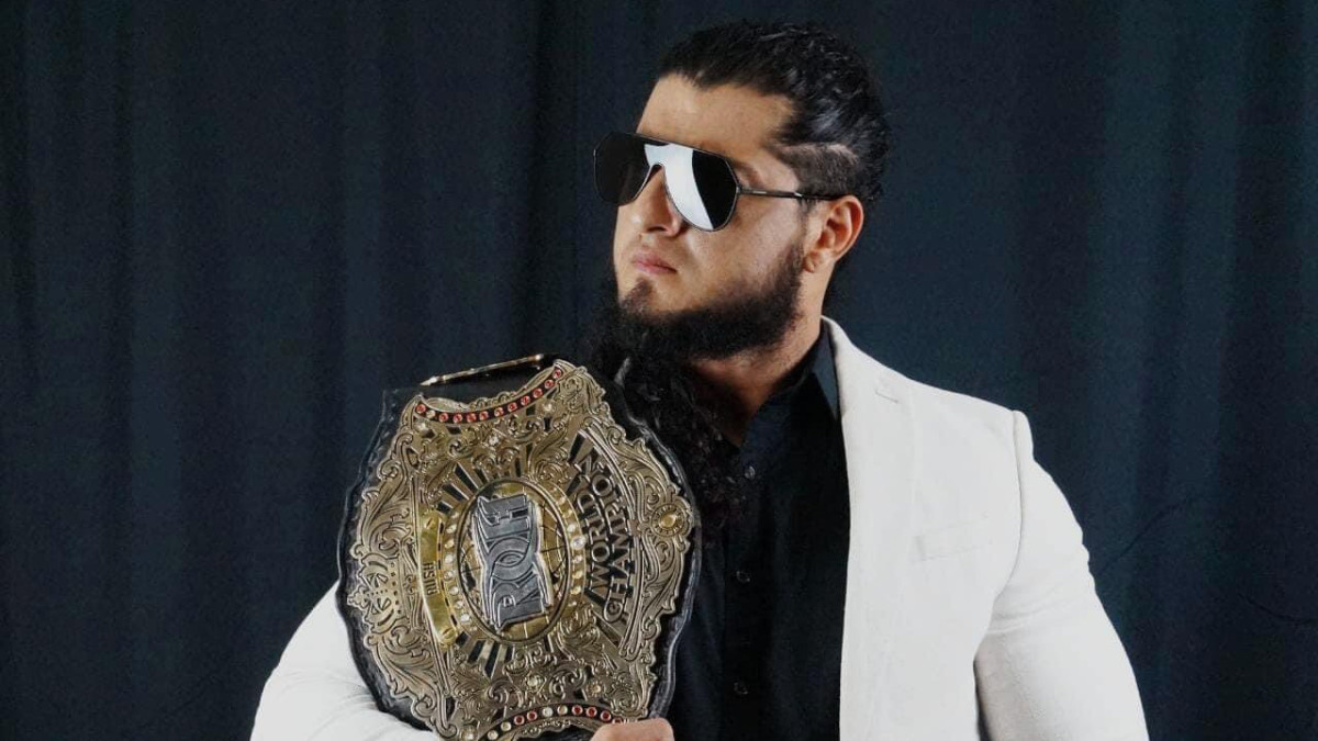 Ring of Honor champion Rush poses with his title