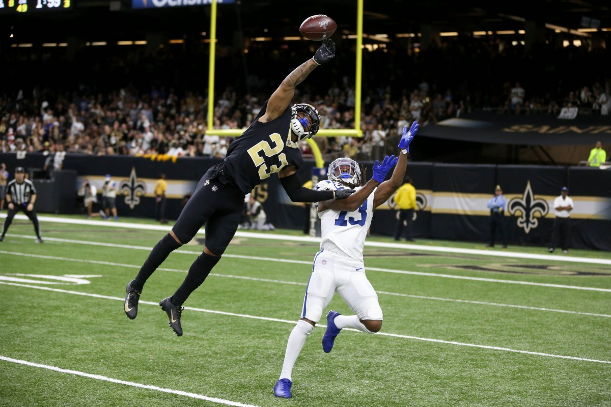 New Orleans cornerback Marshon Lattimore (23) defends a pass intended for Colts receiver T.Y. Hilton (13). Mandatory Credit: Chuck Cook-USA TODAY Sports
