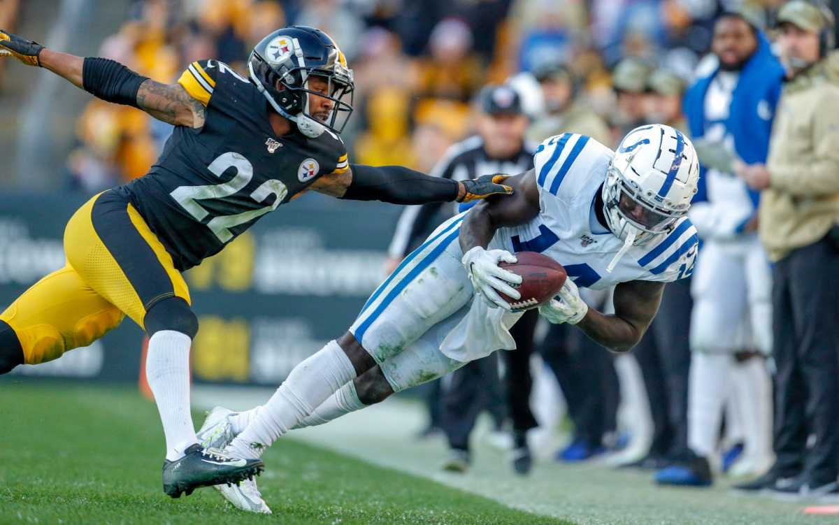 Indianapolis Colts wide receiver Zach Pascal (14) pulls in a sideline catch around Pittsburgh Steelers cornerback Steven Nelson (22) at Heinz Field in Pittsburgh, Pa., on Sunday, Nov. 3, 2019. Indianapolis Colts Vs Pittsburgh Steelers Week 9 Nfl Regular Season