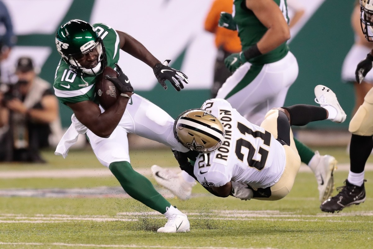 New York Jets receiver Deonte Thompson (10) is tackled by New Orleans Saints defensive back Patrick Robinson (21). Mandatory Credit: Vincent Carchietta-USA TODAY