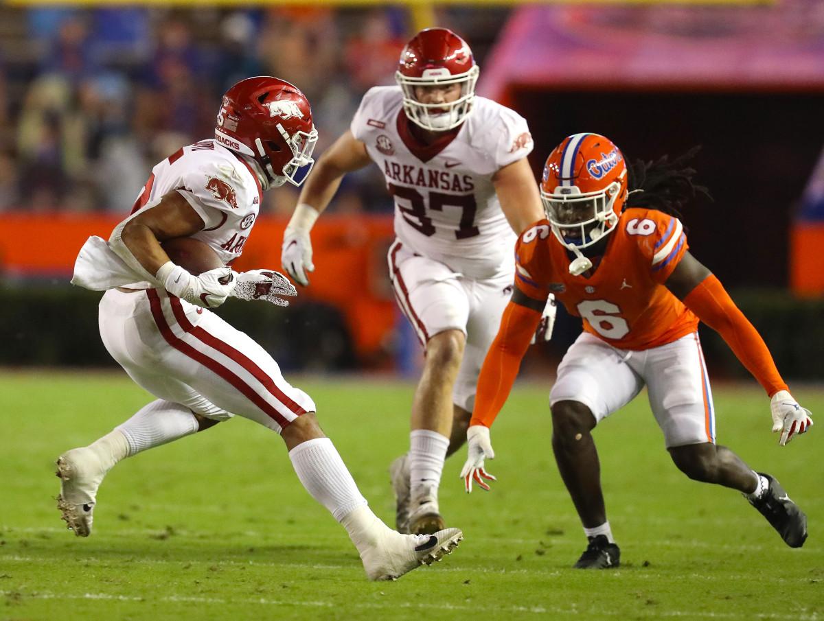 Nov 14, 2020; Gainesville, FL, USA; Arkansas Razorbacks running back Rakeem Boyd (5) is defended by Florida defender Shawn Davis (6) during a football game against Florida at Ben Hill Griffin Stadium.