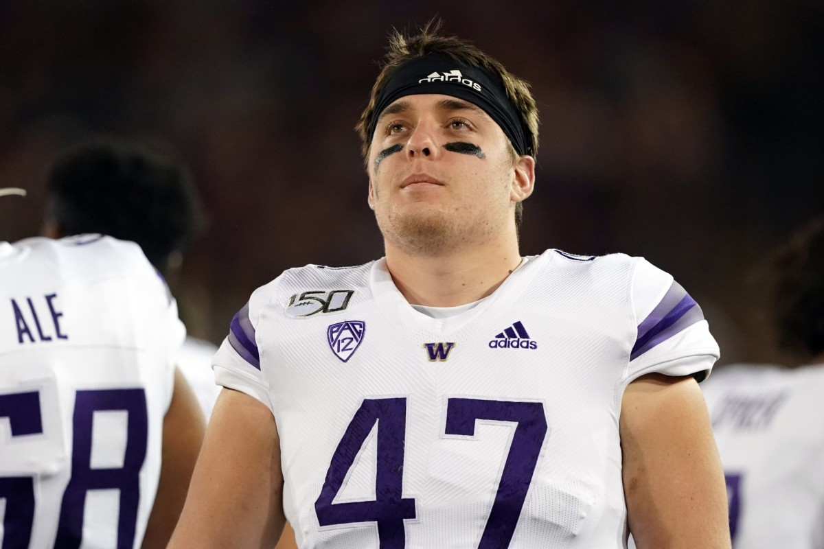 Corey Luciano is now a center and a tackle after the UW first used him at tight end.