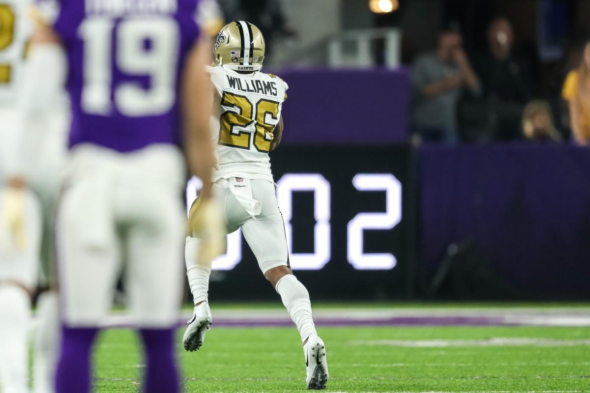New Orleans cornerback P.J. Williams (26) intercepts a pass for a touchdown during the third quarter against Minnesota. Mandatory Credit: Brace Hemmelgarn-USA TODAY