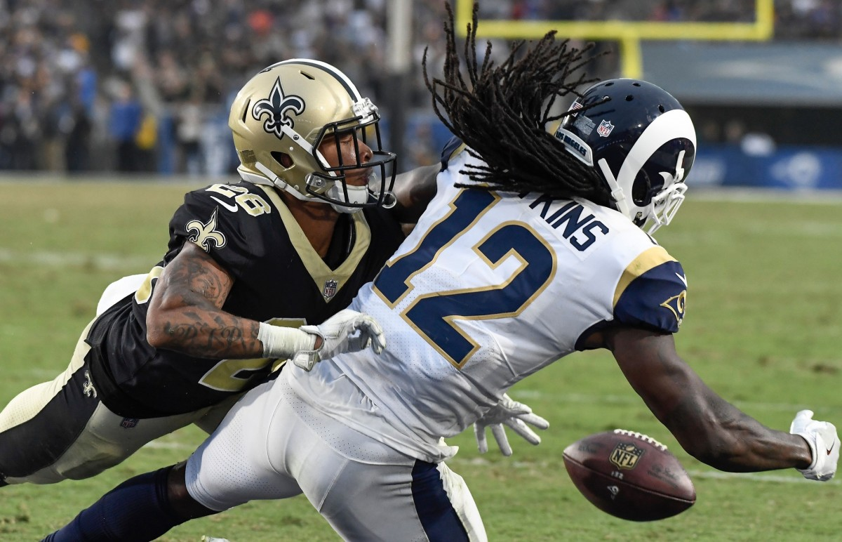 New Orleans cornerback P.J. Williams (26) breaks up a pass in the end zone to Rams receiver Sammy Watkins (12). Mandatory Credit: Robert Hanashiro-USA TODAY Sports