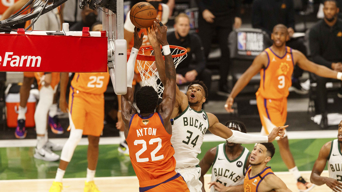 Milwaukee Bucks forward Giannis Antetokounmpo defends Phoenix Suns center Deandre Ayton during the fourth quarter during game four of the 2021 NBA Finals.