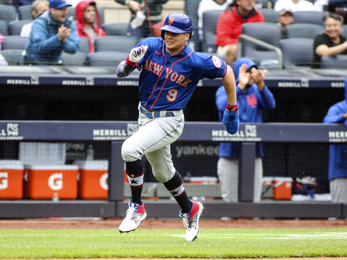 Jul 3, 2021; Bronx, New York, USA;  New York Mets center fielder Brandon Nimmo (9) heads home to score the first run of the game in the fifth inning against the New York Yankees at Yankee Stadium.