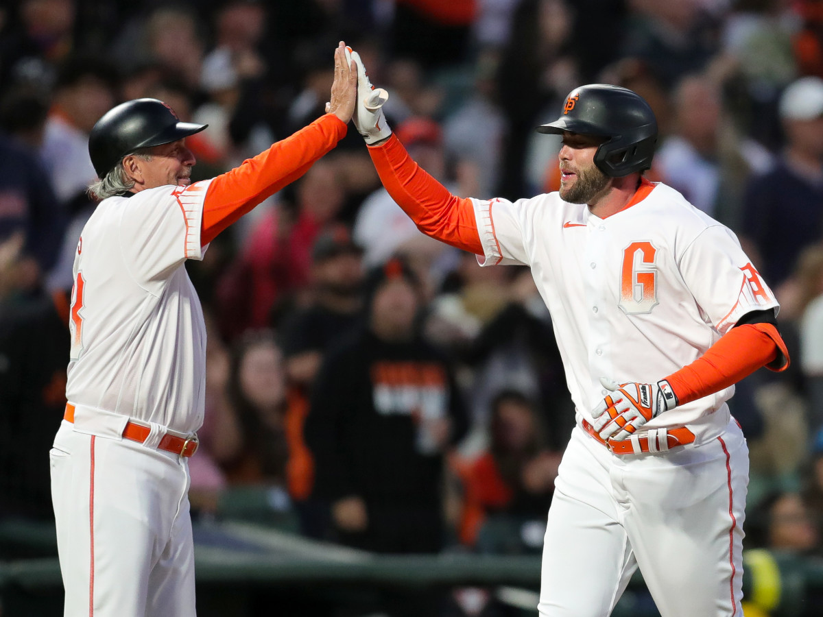 Jul 9, 2021; San Francisco, California, USA; San Francisco Giants first baseman Darin Ruf (33) celebrates with third base coach Ron Wotus (23) after hitting a home run during the fifth inning against the Washington Nationals at Oracle Park.