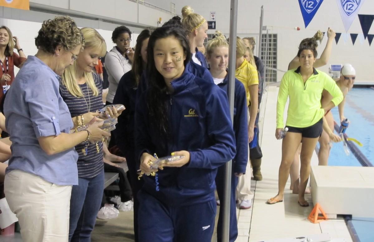 Stephanie Au receives award from coach Teri McKeever.