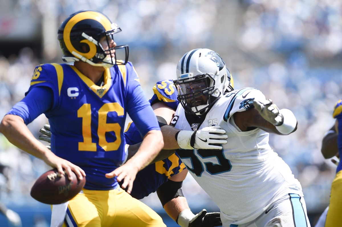 Rams quarterback Jared Goff (16) looks to pass as Carolina Panthers defensive tackle Kawann Short (99) pressures. Mandatory Credit: Bob Donnan-USA TODAY