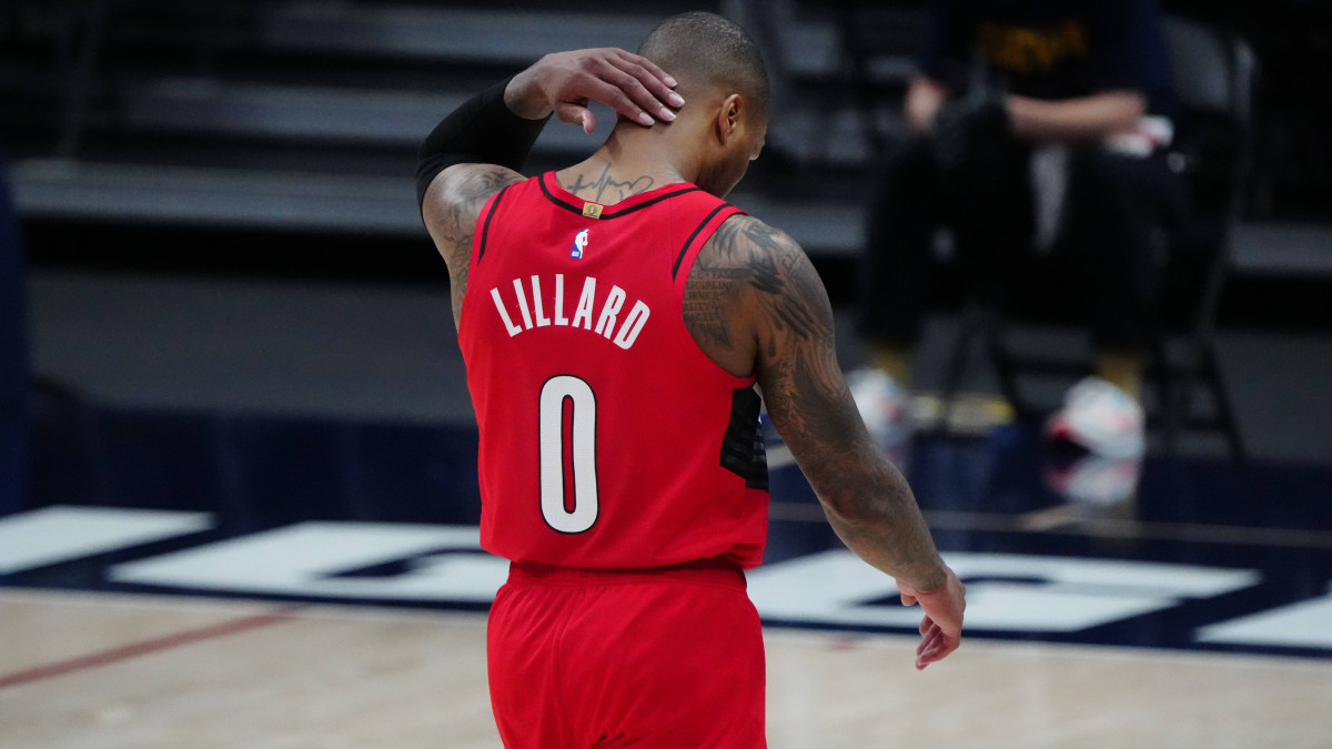 Portland Trail Blazers guard Damian Lillard (0) leaves the court after a double overtime loss to Denver Nuggets during game five in the first round of the 2021 NBA Playoffs. at Ball Arena.