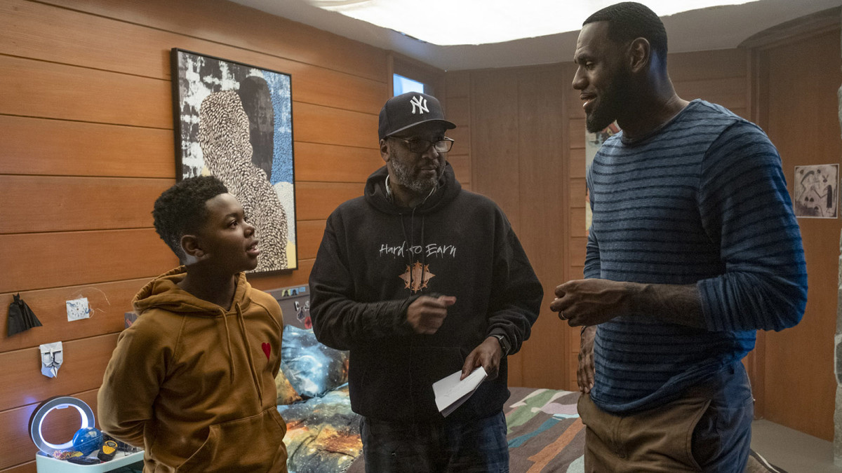 """(L-r) Cedric Joe, Director Malcolm D. Lee and LeBron James on the set of """"SPACE JAM: A NEW LEGACY,"""" a Warner Bros. Pictures release."""