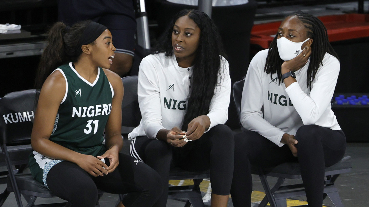 Erica Ogwumike (31) chats with sisters Chiney Ogwumike (center) and Nneka Ogwumike (right) during Nigeria's exhibition loss to U.S. women's basketball