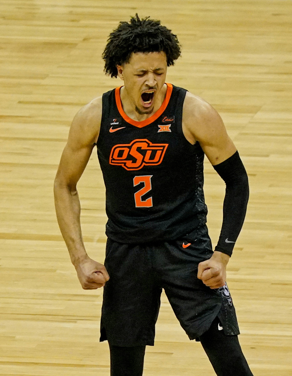 Oklahoma State Cowboys guard Cade Cunningham reacts after scoring against the Texas Longhorns
