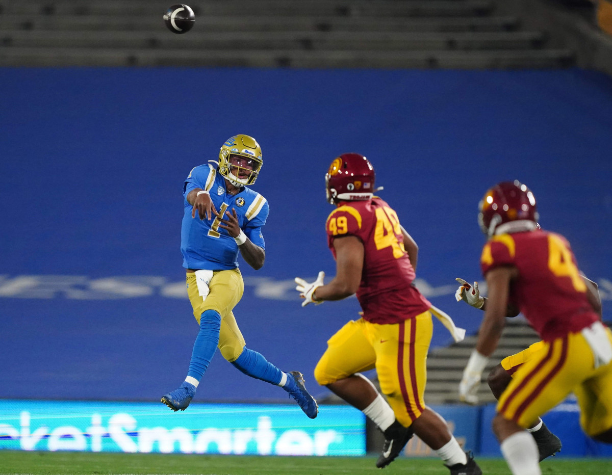 Dorian Thompson-Robinson lets a pass fly against USC in the 2020 victory bell game.