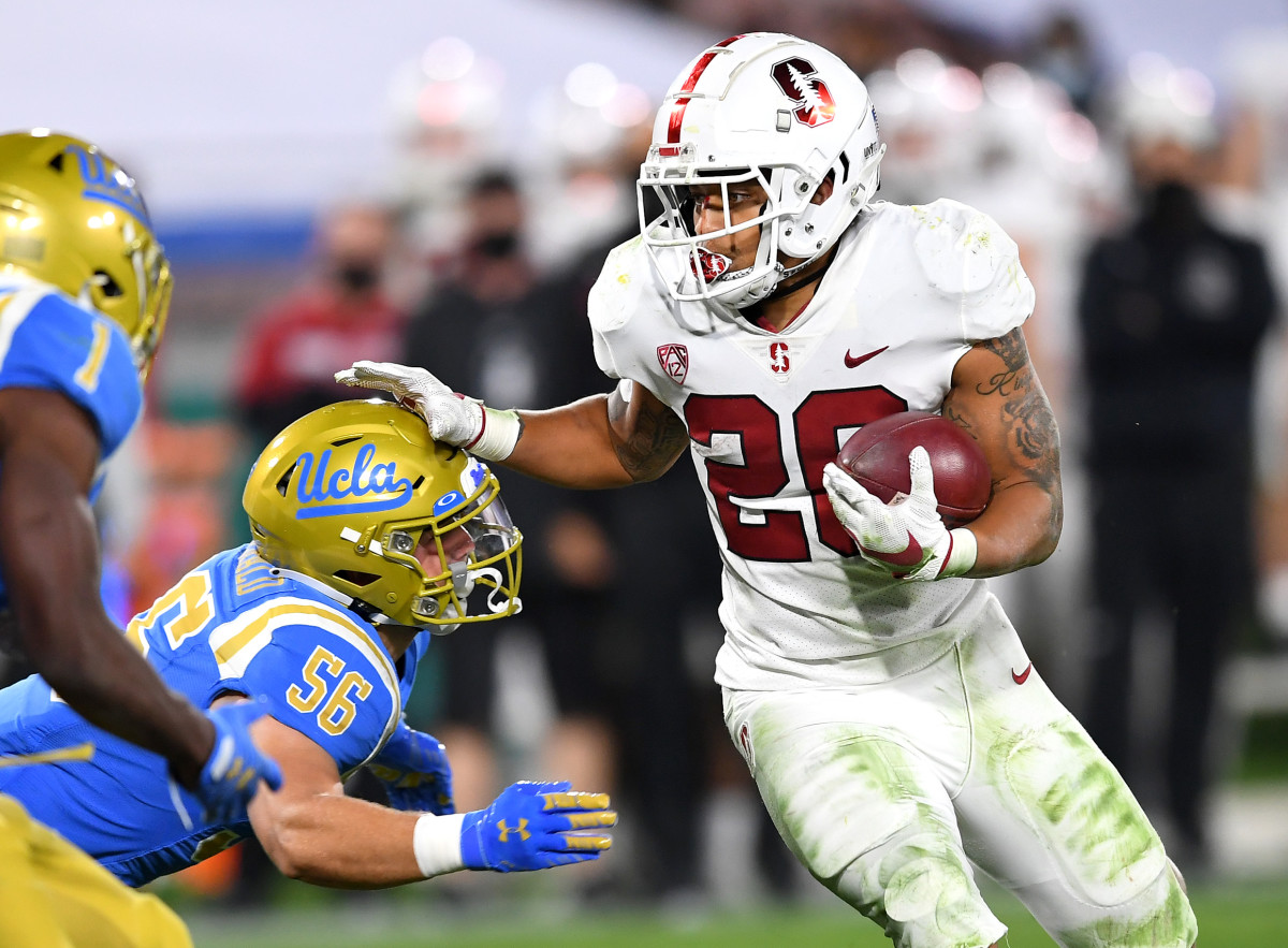 Austin Jones runs the ball against UCLA.