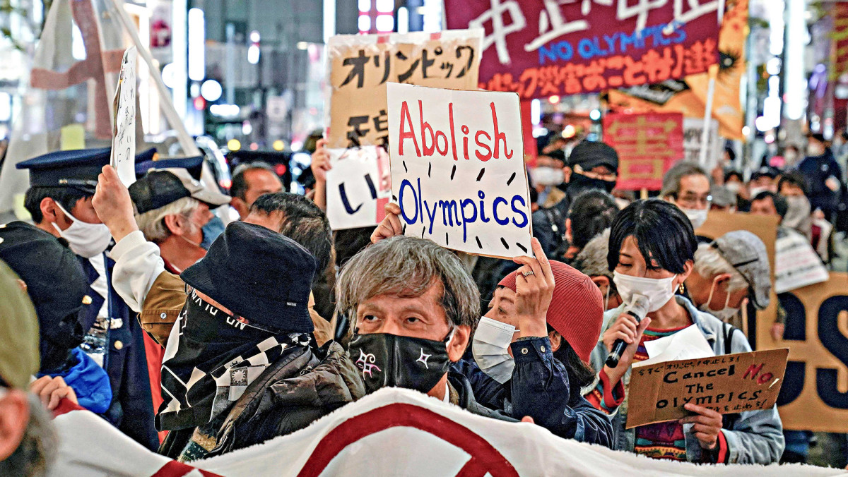 Anti-Olympic demonstrators took to the streets of Tokyo in March after the torch relay began.undefined