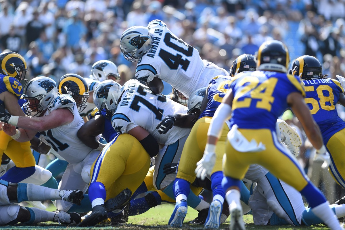 Carolina Panthers fullback Alex Armah (40) dives over the pile for a touchdown. Mandatory Credit: Bob Donnan-USA TODAY Sports