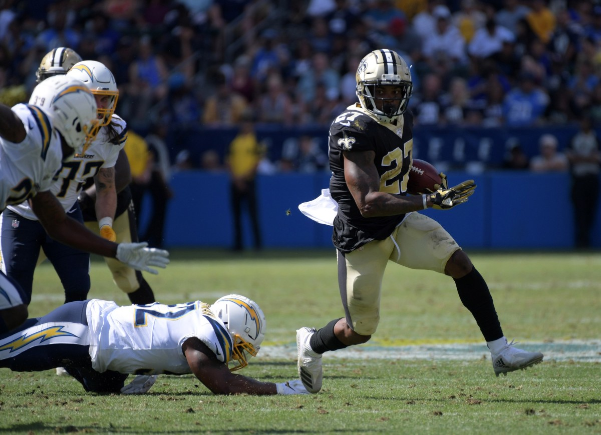 New Orleans Saints running back Dwayne Washington (27) carries the ball against the Chargers. Mandatory Credit: Kirby Lee-USA TODAY Sports
