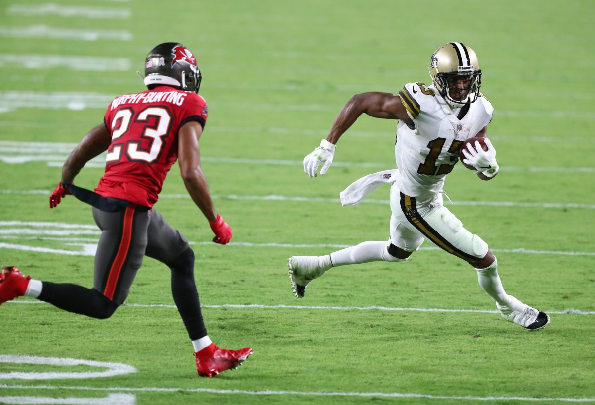 New Orleans Saints wide receiver Michael Thomas (13) runs the ball against Tampa Bay Buccaneers cornerback Sean Murphy-Bunting (23). Mandatory Credit: Kim Klement-USA TODAY Sp