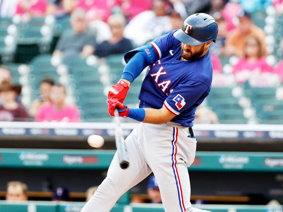 Jul 21, 2021; Detroit, Michigan, USA; Texas Rangers center fielder Joey Gallo (13) hits a single in the second inning against the Detroit Tigers at Comerica Park.