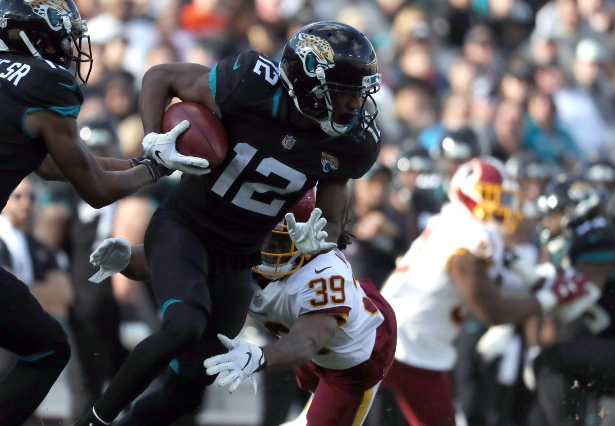 Jacksonville Jaguars receiver Dede Westbrook (12) runs with the ball against the Washington Redskins. Mandatory Credit: Kim Klement-USA TODAY